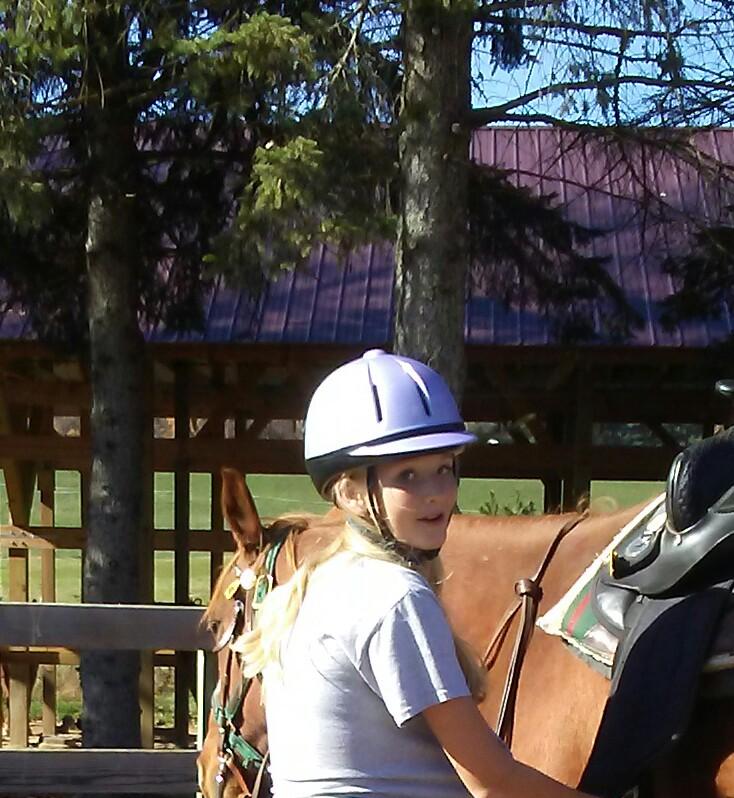 Horse - Rider smile while tacking